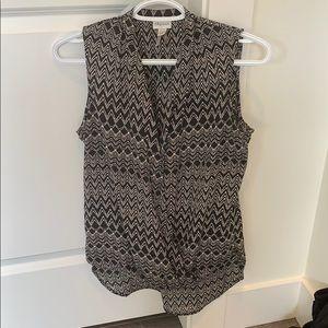 Black and white patterned sleeveless blouse